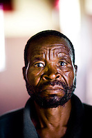"""61 year old Cletios has been the victim of political violence due to his opposition to the ruling Zanu PF. """"For 3 days they [Zanu PF supporters] came to my house. They were singing. They would come twice a day, in the afternoon and the evening. When this happened I would go to the police. What I saw is that a good number of the police were supporting ZPF."""" He says, """"At 12 o clock on 26 June, more than 200 members of ZPF supporters came. All of them were wearing ZPF t-shirts. They were in 2 groups. Each group had a commander. They came to my house and tried to steal the vegetables from my market garden. I didn't allow them. They went away and a bigger group came back. They tried to force open my gate and I threatened the man who wanted to open the gate with a metal rod. I found a heavy rock, weighing about 2kg. I came out of my house and was prepared for a fight where I might die. They ran away."""""""