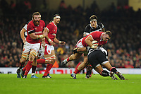 Wales Dillon Lewis is tackled by Barbarians Campese Maafu during the International friendly match between Wales and Barbarians at the Principality Stadium in Cardiff, Wales, UK. Saturday 30 November 2019.