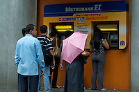 lining up at a ATM view from the car window Manila, Philippines