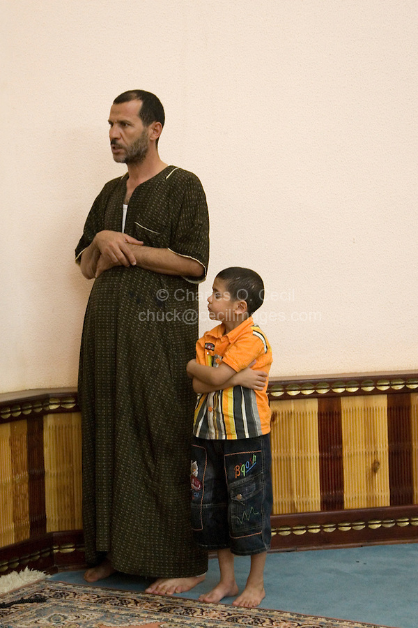 Tripoli, Libya - Praying, father and son.