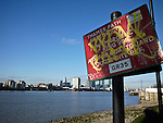 Graffiti on a sign along the Thames Path in Greenwich London England