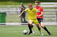 Benjamin Old of the Wellington Phoenix competes for the ball with Samuel Field of Canterbury United during the ISPS Handa Men's Premiership - Wellington Phoenix Reserves v Canterbury United at Fraser Park, Wellington on Saturday 9 January 2021.<br /> Copyright photo: Masanori Udagawa /  www.photosport.nz