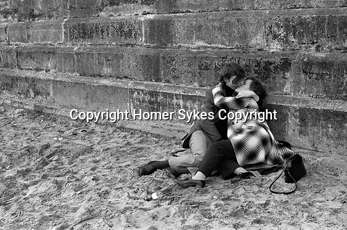 Bridlington Yorkshire, 1972, couple teens on beach kissing.