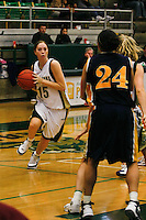 Senior Kerra Sutton-Wodarski  of Point Loma Nazarene University moves past defenders from UW Eau Claire during the 2007 Surf N Slam Women?s Basketball Tournament at Golden Gymnasium on the PLNU campus in San Diego, Saturday December 29 2007.   Sutton-Wodarski and fellow senior Kati Hilbelink scored 13 points each in the Sea Lions 71 - 51 victory over Eau Claire, securing fourth place in the Surf N Slam.   PLNU played host to the tournament December 27, 28 and 29.  The eight team field included seven NCAA DIII schools; UW Stevens Point, UW Eau Claire, Carroll (WI), Gustavus Adolphus (MN), Ithaca (NY), Maryville (MO), Rivier (NH). Point Loma was the only NAIA school competing.  The tournament was won by Maryville who defeated Gustavus Aldolphus 68-64 in the final game on Saturday.
