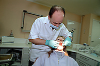 Patient having her teeth examined by a dentist, during a regular dental check-up appointment...This image may only be used to portray the subject in a positive manner.