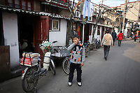 CHINA. Shanghai. A young boy in the old town. Shanghai is a sprawling metropolis or 15 million people situated in south-east China. It is regarded as the country's showcase in development and modernity in modern China. This rapid development and modernization, never seen before on such a scale has however spawned countless environmental and social problems. 2008.