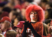 23 December 2006: A young Utah fan watches from the stands during the 2006 Bell Helicopters Armed Forces Bowl between The University of Tulsa and The University of Utah at Amon G. Carter Stadium in Fort Worth, TX.