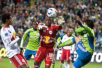 Fredy Montero (r) tries to get one passed New York goalkeeper Bouna Coundoul (c) as the Seattle Sounders lost to the New York Red Bulls, 1-0, in an MLS match on Saturday, April 3, 2010 at Qwest Field in Seattle, WA.