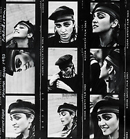 BNPS.co.uk (01202) 558833. <br /> Pic: PeterAnderson/Bonhams/BNPS<br /> <br /> A rare contact sheet of photos of a playful Madonna during an early British shoot has emerged for sale.<br /> <br /> The queen of pop posed for a photoshoot with London photographer Peter Anderson in Soho in 1983.<br /> <br /> The dark-haired singer sports a hat and dark clothing in the images where she mixes up her facial expressions.