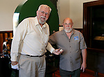 Curator Bob Nylen and coiner Ken Hopple pose following a ceremony for the final design in a commemorative Sesquicentennial series at the Nevada State Museum, in Carson City, Nev., on Wednesday, Sept. 3, 2014. <br /> Photo by Cathleen Allison