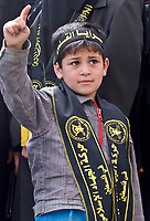 """Palestinian child  supporters of the Islamic Jihad movement attend a rally in Gaza City on March 29, 2008 urging Arab leaders gathered in for the Arab Summit in Damascus to support a bid to bridge the rift between rival Palestinian factions. President Bashar al-Assad opened a boycott-hit Arab summit today in the absence of half of the region's leaders, many of whom blame Damascus for the political crisis in Lebanon.""""photoo by Fady Adwan"""""""
