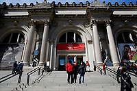 NEW YORK, NEW YORK - MARCH 19: People walk in front of The MET Museum on March 19, 2021 in New York. The Met Museum is considering selling some of its works to support itself after claming that the pandemic has caused a loss of revenue of $150 million in about 18 months. (Photo by John Smith/VIEWpress)