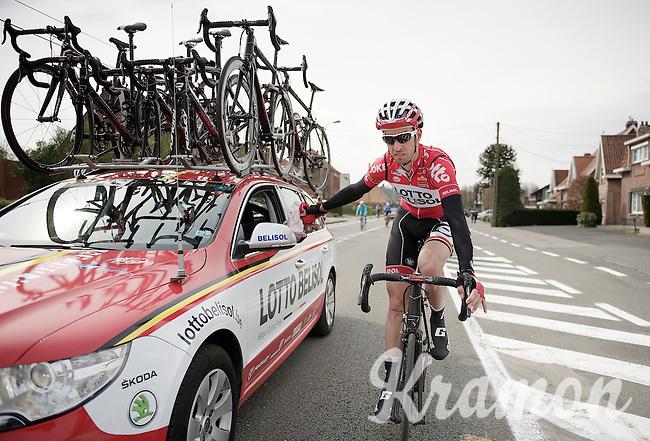 Kenny Dehaes (BEL/Lotto-Belisol) returning his rain jacket to the teamcar<br /> <br /> Dwars Door Vlaanderen 2014