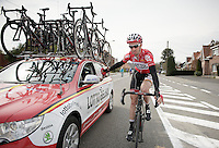 Kenny Dehaes (BEL/Lotto-Belisol) returning his rain jacket to the teamcar<br /> <br /> Dwars Door Vlaanderen 2014