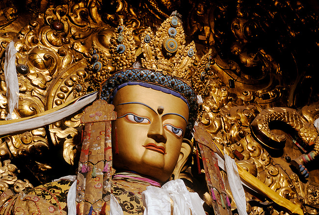 Beautiful JEWEL ENCRUSTED STATUE OF MAITREYA (future Buddha) in the MAIN ASSEMBLY HALL at DREPUNG MONASTERY
