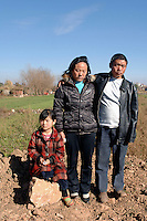 Mrs. Hu Ye Qin,33, Mr. Huang He, 37,  and one of their daughters, He Lun - 7 years old. the parents were sterilized by force ,  the husband with no anesthetic for not being able to the fine for having too many children.