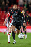 1st October 2021;  Bet365 Stadium, Stoke, Staffordshire, England; EFL Championship football, Stoke City versus West Bromwich Albion; Kyle Bartley of West Bromwich Albion chases a loose ball