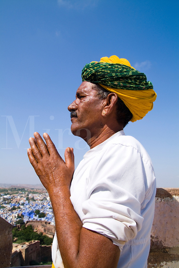Great image of colorful Hindu man with turban in beautiful BLUE CITY of Jodhpur at Fort Mehrangarh in Rajasthan India