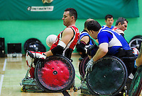 15 AUG 2011 - LEEDS, GBR - Canada's Mike Whitehead (left) scores during the wheelchair rugby exhibition match against Great Britain (PHOTO (C) NIGEL FARROW)