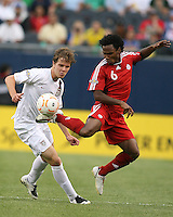 Julian DeGuzman flicks the ball away from Michael Bradley.USA beat Canada 2-1 in the semifinal of the 2007 Gold Cup at Soldier Field in Chicago on June 21 2007 and will meet Mexico in the final.