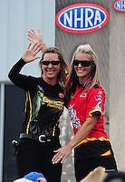 May 1, 2011; Baytown, TX, USA: NHRA pro stock motorcycle rider Angie Smith (right) and Karen Stoffer during the Spring Nationals at Royal Purple Raceway. Mandatory Credit: Mark J. Rebilas-