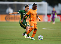 LAKE BUENA VISTA, FL - JULY 18: Darwin Quintero #23 of the Houston Dynamo turns away from Pablo Bonilla #28 of the Portland Timbers during a game between Houston Dynamo and Portland Timbers at ESPN Wide World of Sports on July 18, 2020 in Lake Buena Vista, Florida.