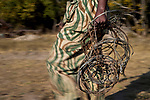 Park scout in anti-poaching patrol carrying confiscated snares, Kafue National Park, Zambia