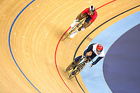 06 AUG 2012 - LONDON, GBR - Jason Kenny (GBR) of Great Britain (right) leads Njisane Nicholas Phillip (TRI) (left) of Trinidad and Tobago during their Individual Sprint semi final second race at the London 2012 Olympic Games track cycling at the Olympic Park Velodrome in Stratford, London, Great Britain .(PHOTO (C) 2012 NIGEL FARROW)