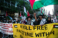NEW YORK, NY - JUNE 15: A large group of pro-Palestinian protesters wave flags during a large protest in New York on June 15, 2021. The solidarity action of hundreds of pro-Palestinians is a form of support against the attacks that has been carried out by the Israeli government. At the same time, Palestinian Prime Minister Mohammad Shtayyeh says the new Israeli government is just as bad as the old one and condemns Naftali Bennett's announcements in support of Israeli settlements. For this reason the demonstrations continue in different parts of the world. (Photo by Pablo Monsalve / VIEWpress via Getty Images