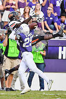 TCU cornerback Kevin White (25) breaks a pass intended for wide receiver Jhajuan Seales (81) during second half of an NCAA football game, Saturday, October 18, 2014 in Fort Worth, Tex. TCU defeated Oklahoma State 42-9. (Mo Khursheed/TFV Media via AP Images)