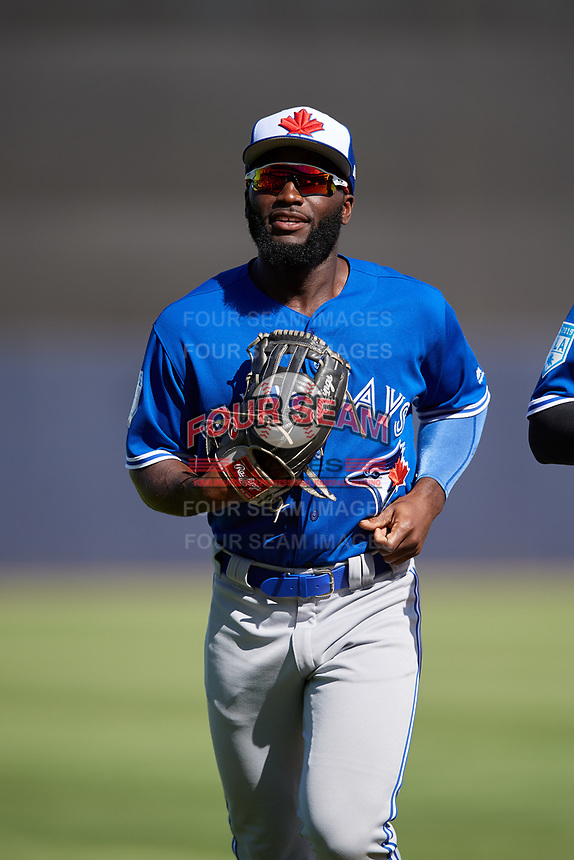 Toronto Blue Jays center fielder Roemon Fields (86) jogs back to the dugout during a Grapefruit League Spring Training game against the New York Yankees on February 25, 2019 at George M. Steinbrenner Field in Tampa, Florida.  Yankees defeated the Blue Jays 3-0.  (Mike Janes/Four Seam Images)