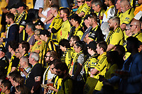 15th March 2020, Wellington, New Zealand;  Phoenix fans stand for a moment silence for members of the Christchurch community effected by the shootings one year ago during the A-League - Wellington Phoenix versus Melbourne Victory football match at Sky Stadium in Wellington on Sunday the 15th March 2020.