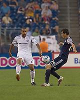 Chicago Fire defender C.J. Brown (2) passes the ball as New England Revolution midfielder Marko Perovic (29) closes. The Chicago Fire defeated the New England Revolution, 1-0, at Gillette Stadium on June 27, 2010.