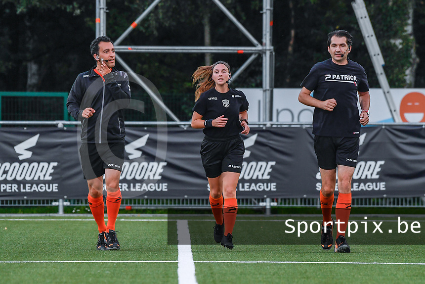 assistant referee Robby Celis , referee Jana Van Laere , assistant referee Erwin Hermans pictured before a female soccer game between  Racing Genk Ladies and Sporting du pays de Charleroi on the fourth matchday of the 2021-2022 season of the Belgian Scooore Womens Super League , friday 10 September 2021  in Genk , Belgium . PHOTO SPORTPIX | STIJN AUDOOREN