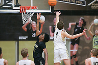 Bentonville forward Caden Miller (4) blocks a shot attempt by Little Rock Central Corey Camper Jr. (32), Saturday, November 14, 2020 during a basketball game at Bentonville High School in Bentonville. Check out nwaonline.com/201115Daily/ for today's photo gallery. <br /> (NWA Democrat-Gazette/Charlie Kaijo)