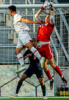 WASHINGTON, DC - SEPTEMBER 6: Virginia goalkeeper Holden Brown (99) makes a save during a game between University of Virginia and University of Maryland at Audi Field on September 6, 2021 in Washington, DC.