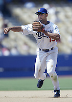 Alex Cora of the Los Angeles Dodgers makes a throw during a 2002 MLB season game at Dodger Stadium, in Los Angeles, California. (Larry Goren/Four Seam Images)