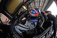 Ryan Hunter-Reay climbs into the #95 Crown Royal-NPN Racing BMW/Riley.