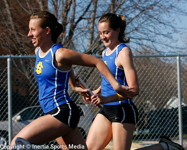 BROOKINGS, SD - April 22nd, 2009 : Ashley Lange and Rachael Hakk of South Dakota State compete in the women's four by one hundred meter relay Wednesday afternoon at the First Annual SDSU Twilight Track Meet at the Brookings High School Track in Brookings, SD. (Photo By Ty Carlson/Inertia)