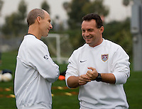 USMNT Head Coach Bob Bradley (l) and Assistant Coach Peter Nowak share a laugh at the beginning of the team's first training session.