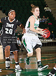 North Texas Mean Green guard Barbara-Scott Kolb (10) and Troy Trojans guard Jasmine Pitts (20) in action during the game between the Troy Trojans and the University of North Texas Mean Green at the North Texas Coliseum,the Super Pit, in Denton, Texas. UNT defeats Troy 57 to 36.....