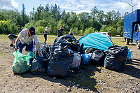 Ordered by Henry<br /> Pictured: Revellers clean up the area from the aftermath of an illegal rave party. Tuesday 1 September 2020<br /> Re: Around 70 South Wales Police officers executed a dispersal order at the site of an illegal rave party, where they confiscated sound gear used by the organisers in woods near the village of Banwen, in south Wales, UK.