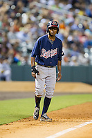 Elmer Reyes (2) of the Gwinnett Braves takes his lead off of third base against the Charlotte Knights at BB&T Ballpark on August 19, 2014 in Charlotte, North Carolina.  The Braves defeated the Knights 10-5.   (Brian Westerholt/Four Seam Images)