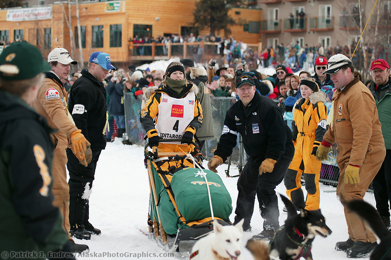 Dog Musher Cali King, in the starting shoot for the 1000 mile 2003 Iditarod sled dog race from Fairbanks to Nome, Alaska . Lack of snow along the normal trail route further south forced the relocation of the restart on the Chena River in Fairbanks.