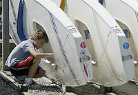 Kevin Daniel-Hamberg plays with sailboats along side Lake Erie Wednesday, July 5, 2006, in Lakeside, Ohio.