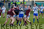 St Marys Daniel Daly holds on to possession as foru Piarsaigh na Dromoda players surround him.