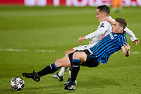 16th March 2021; Madrid, Spain;  Lucas Vazquez of Real Madrid and Robin Gosens of Atalanta during the Champions League match, round of 16, between Real Madrid and Atalanta played at Alfredo Di Stefano Stadium