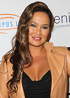 HOLLYWOOD, LOS ANGELES, CA, USA - SEPTEMBER 18: Tia Carrere arrives at the 'Get Lucky For Lupus' 6th Annual Poker Tournament held at Avalon on September 18, 2014 in Hollywood, Los Angeles, California, United States. (Photo by Celebrity Monitor)