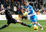 Motherwell v St Johnstone…05.05.18…  Fir Park    SPFL<br />David Wotherspoon is tackled by Carl McHugh<br />Picture by Graeme Hart. <br />Copyright Perthshire Picture Agency<br />Tel: 01738 623350  Mobile: 07990 594431