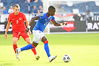 KANSAS CITY, KS - JULY 15: Alex Christian #22 of Haiti with the ball during a game between Canada and Haiti at Children's Mercy Park on July 15, 2021 in Kansas City, Kansas.